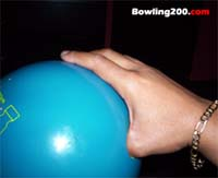 Thumb inserted into bowling ball
